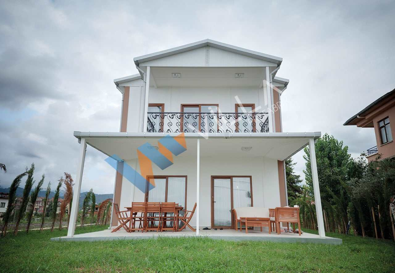 subasman nedir-iki katlı beyaz modern görünümlü bir prefabrik ev