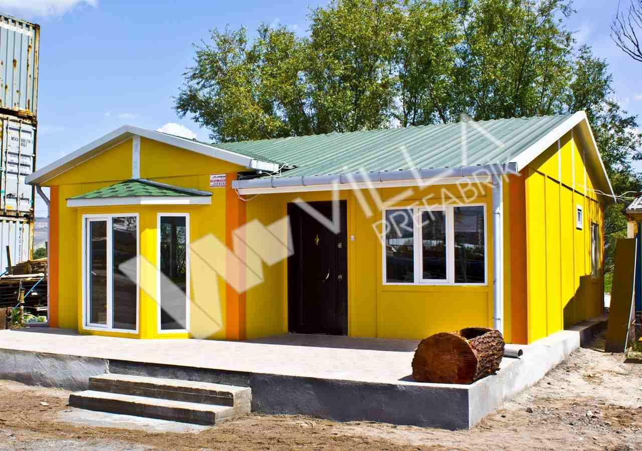sarı renkli tek katlı prefabrik ev